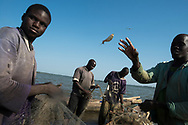 Local fishermen clean their nets along the banks of the Casamance River. Fishing is crucial to the local economy. Rising sea levels and drought due to global warming and climate change are causing the salinization of the complex mangrove ecosystem of the coastal zone, with adverse affects on the fish, shrimp and shellfish stocks that local communities depend on for their livelihoods. Sédhiou, Sénégal. 12/11/2014.