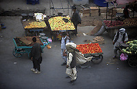 KABUL,  street's vendors sell vegetables in a windy street of Jadda's district.