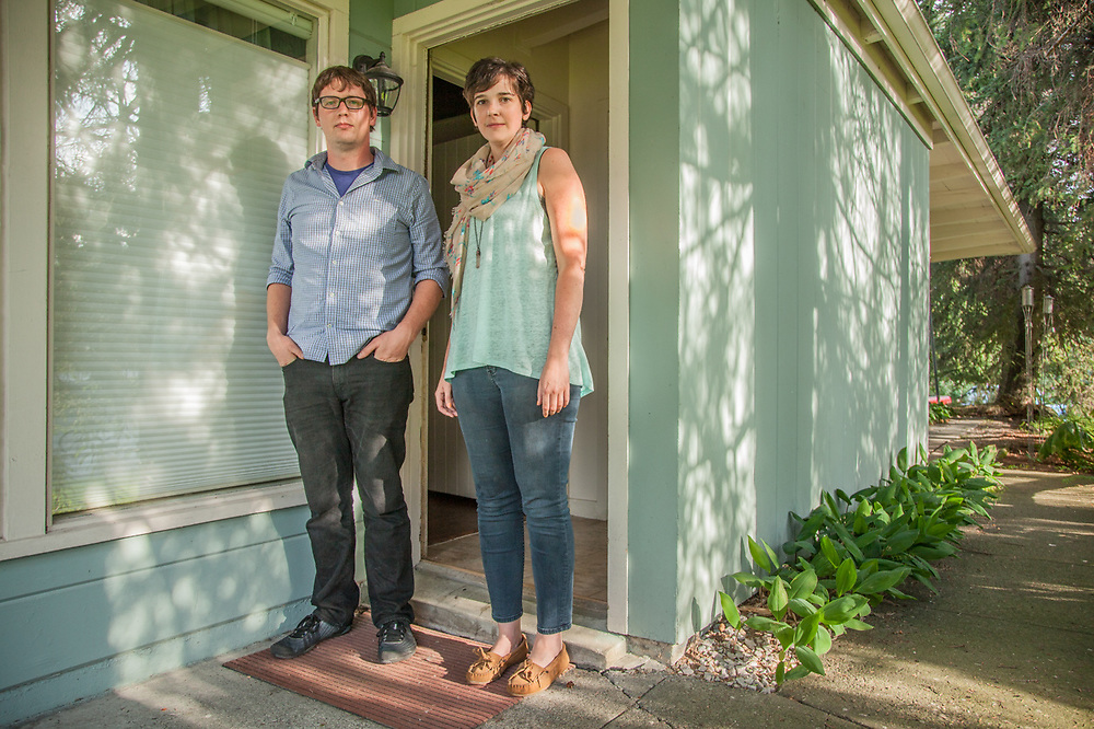 """Jay Hall and Donna Freeman at their home in Bootlegger's Cove in downtown Anchorage   """"We would love to buy a house...we would love to buy this house. Unfortunately, getting a place of our own may be a few years off.""""  -Donna Freeman"""
