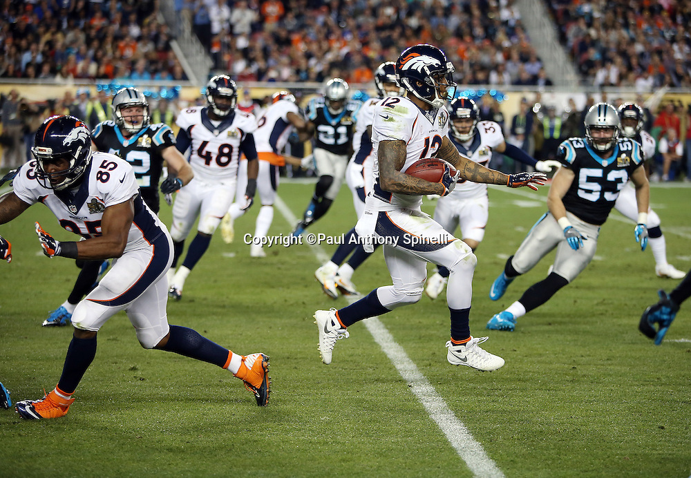 Denver Broncos wide receiver Andre Caldwell (12) returns a kick during the NFL Super Bowl 50 football game against the Carolina Panthers on Sunday, Feb. 7, 2016 in Santa Clara, Calif. The Broncos won the game 24-10. (©Paul Anthony Spinelli)