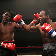 "Berthin Rousseau (dreadlocks) fights Howard Reece during the ""Boxeo Telemundo"" boxing match at the Kissimmee Civic Center on Friday, March 14, 2014 in Kissimmme, Florida. (Photo/Alex Menendez)"