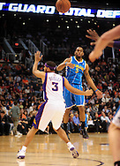 Jan. 30, 2011; Phoenix, AZ, USA; New Orleans Hornets guard Marcus Thornton (5) makes a pass over Phoenix Suns forward Jared Dudley at the US Airways Center. The Suns defeated the Hornets 104-102.  Mandatory Credit: Jennifer Stewart-US PRESSWIRE