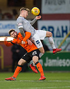 12th January 2019, Tannadice Park, Dundee, Scotland; Scottish Championship football, Dundee United versus Dunfermline Athletic; Tom Beadling of Dunfermline Athletic competes in the air with Cammy Smith of Dundee United
