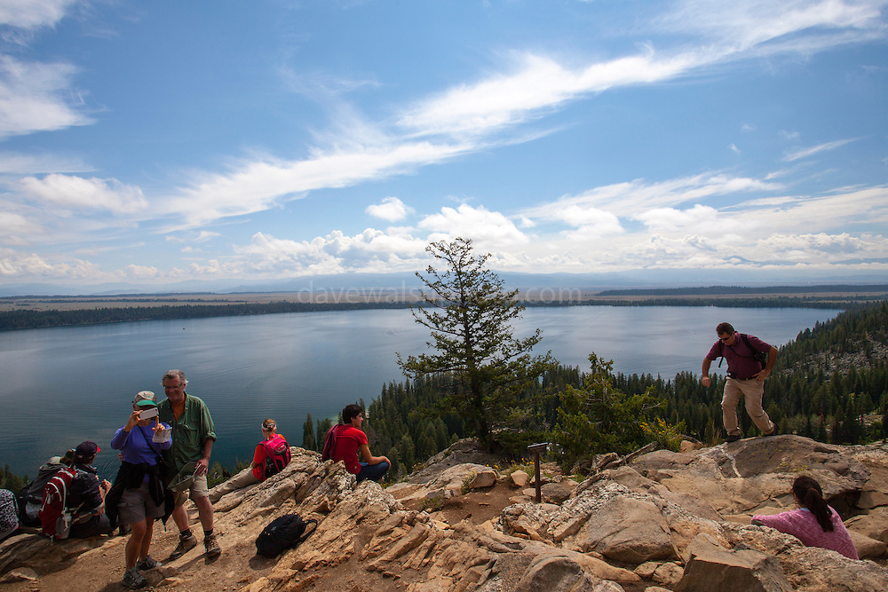 Tourists at Inspiration Point, above Jenny Lakeon the Cascade Creek Trail, at Grand Teton National Park, Wyoming