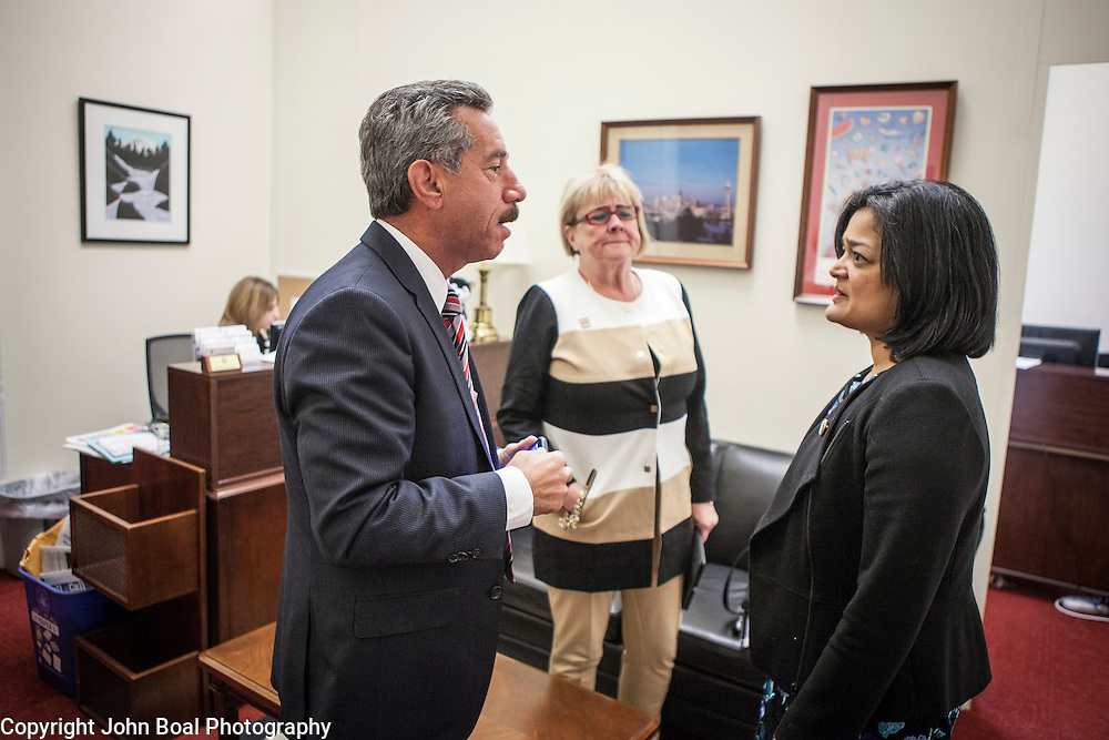 Representative Pramila Jayapal (D-WA, 7) greets James Pishue, President and CEO, and Gloria Stewart of the Washington Bankers Association, on Tuesday, January 31, 2017.  John Boal photo/for The Stranger