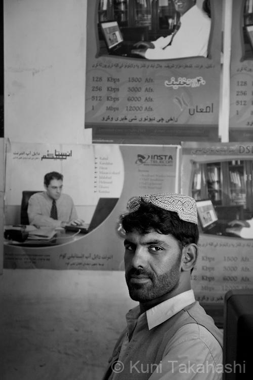 Mohammad Nasim, 25, Kandahar, telecom shop clark.in Kandahar, Afghanistan on Aug 17, 2011.(Photo by Kuni Takahashi)