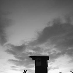 Newport Beach Lifeguard Tower B black and white silhouette photo. Newport Beach California is a popular beach city along the Pacific Ocean in Orange County CA. Photo is high resolution. Copyright ⓒ 2017 Paul Velgos with All Rights Reserved.
