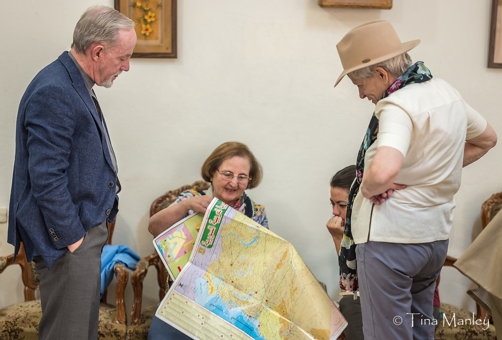 Group looks on as Mary shows our route on an Arabic map of Syria.
