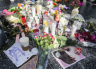 A makeshift memorial surrounds David Bowie's star on the Hollywood Walk of Fame in Los Angeles, Monday, Jan. 11, 2016. Bowie, the infinitely changeable, fiercely forward-looking songwriter who taught generations of musicians about the power of drama, images and personae, died Sunday surrounded by family. He was 69. Bowie died after an 18-month battle with cancer. (Photo by Ringo Chiu/PHOTOFORMULA.com)<br /> <br /> Usage Notes: This content is intended for editorial use only. For other uses, additional clearances may be required.