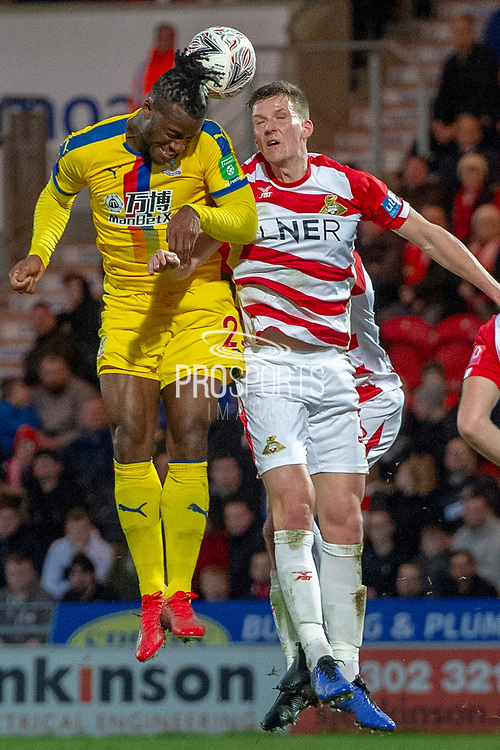 Crystal Palace forward Michy Batshuayi (23) arieal battle with Doncaster Rovers defender Paul Downing (31) during the The FA Cup 5th round match between Doncaster Rovers and Crystal Palace at the Keepmoat Stadium, Doncaster, England on 17 February 2019.