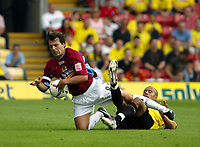 Photo. Chris Ratcliffe. Digitalsport<br /> Watford v Burnley. The League Championship. 14/08/2004<br /> Burnley's Robbie Blake tackled from behind by Watford's James Chambers