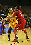 February 11 2013: Iowa Hawkeyes guard Kathy Thomas (13) looks to get the ball around Nebraska Cornhuskers guard Tear'a Laudermill (1) during the first half of the NCAA women's basketball game between the Nebraska Cornhuskers and the Iowa Hawkeyes at Carver-Hawkeye Arena in Iowa City, Iowa on Monday, February 11 2013.