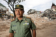 Padang, Western Sumatra, Indonesia, 7th October 2009:?Major Haris who is the senior officer in charge of the district containing the Ambacang Hotel stands in front of the hotel wreckage  following a devastating earthquake in Western Sumatra that claimed the lives of an estimated 2000 people.?Photo: Joseph Feil
