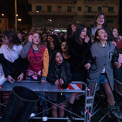 A group of young fans during the concert for the Epiphany at Piazza Mercato, Naples.