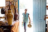 Faouzia Atik, 26, unloads ceramics in a small workshop in Nabeul, Tunisia.
