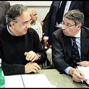 Nella foto Sergio Marchionne e Paolo Rebaudengo al tavolo tra Governo, FIAT, sindacati ed enti locali per discutere del futuro degli investimenti del Lingotto, dopo la decisione di trasferire la produzione della monovolume in Serbia, nella sala Giunta regionale in Piazza Castello a Torino.