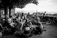 Picture by Andrew Tobin/Tobinators Ltd +44 7710 761829<br /> 04/08/2013<br /> Riders relax after the qualification rounds during the Cycle Messenger World Championships held in Lausanne, Switzerland. Started in 1993 by Achim Beier from Berlin, the championships are not only a sporting contest but an opportunity to unite friends and bicycle enthusiasts worldwide. The event comprises a number of challenges including a sprint, a track stand (longest time stationary on the bike), a cargo race where heavy loads are carried on special bikes, and the main race. The course winds through central Lausanne and includes bridges, stairs, cobbles, narrow alleyways and challenging hills. The main race simulates the job of a bike courier making numerous drops and pickups across the city. Riders need to check in at specific checkpoints, hand over their delivery and get a new one. The main race can take up to 4 hours for each competitor to complete.