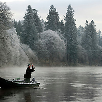 Scottish Salmon Season Opens on the River Tay at Dunkeld.....16.01.12<br /> Ghillie Jim Ferrie of Dunkeld Fishings casts into the frozen waters of the River tay at Dunkeld after the season had been opened by St Johnstone Manager Steve Lomas<br /> Picture by Graeme Hart.<br /> Copyright Perthshire Picture Agency<br /> Tel: 01738 623350  Mobile: 07990 594431