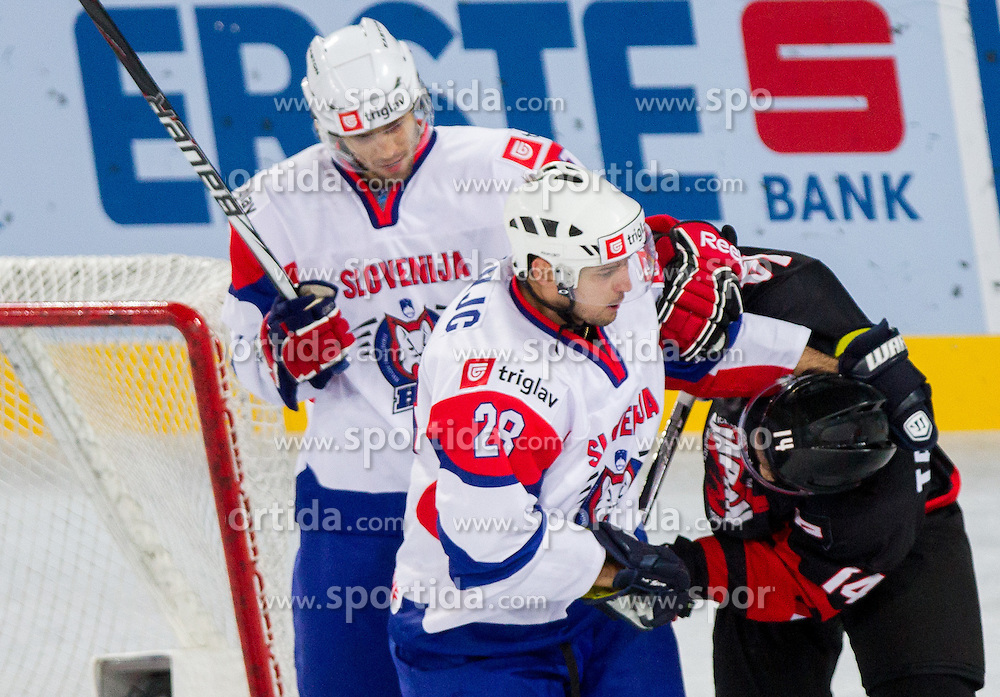 Ales Kranjc of Slovenia in fight with Go Tanaka of Japan during ice-hockey match between Slovenia and Japan at IIHF World Championship DIV. I Group A Slovenia 2012, on April 16, 2012 in Arena Stozice, Ljubljana, Slovenia. (Photo by Vid Ponikvar / Sportida.com)