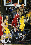 January 19 2013: Wisconsin Badgers forward Ryan Evans (5) puts up a shot as Iowa Hawkeyes center Gabriel Olaseni (0) defends during the first half of the NCAA basketball game between the Wisconsin Badgers and the Iowa Hawkeyes at Carver-Hawkeye Arena in Iowa City, Iowa on Sautrday January 19 2013. Iowa defeated Wisconsin 70-66.