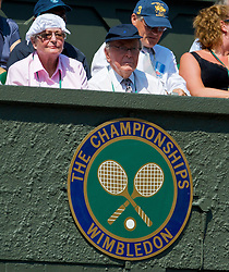 LONDON, ENGLAND - Tuesday, June 30, 2009: An elderly woman wears a handkerchief hat during the Ladies' Singles Quarterfinal on day eight of the Wimbledon Lawn Tennis Championships at the All England Lawn Tennis and Croquet Club. (Pic by David Rawcliffe/Propaganda)