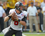 August 31 2013: Northern Illinois Huskies quarterback Jordan Lynch (6) drops back to pass during the second quarter of the NCAA football game between the Northern Illinois Huskies and the Iowa Hawkeyes at Kinnick Stadium in Iowa City, Iowa on August 31, 2013. Northern Illinois defeated Iowa 30-27.