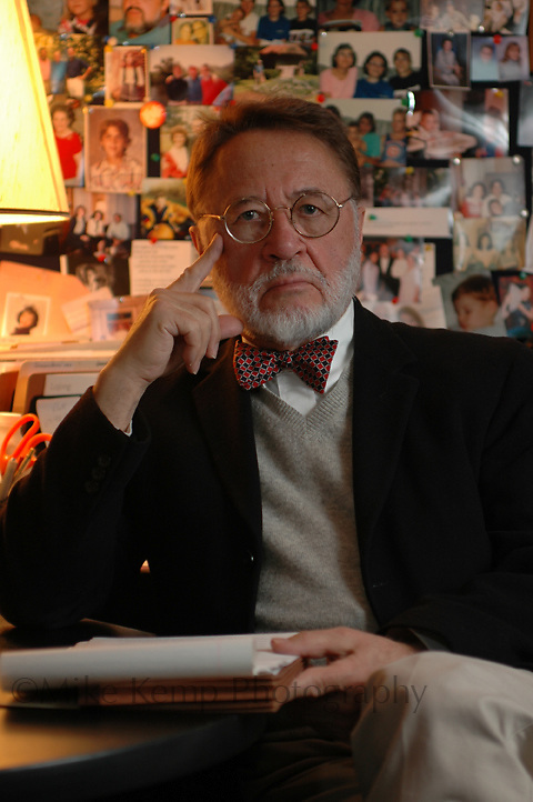 Norb Schedler poses for a portrait in his office prior to his retirement from the University of Central Arkansas. Schedler founded the Honors College, and says that many students were intimidated by his stare while giving presentations.
