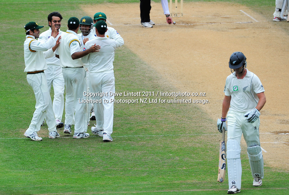 Pakistan players celebrate the dismissal of James Franklin for 6. 2nd cricket test match - New Zealand Black Caps v Pakistan, day four at the Basin Reserve, Wellington, New Zealand on Tuesday, 18 January 2011. Photo: Dave Lintott / photosport.co.nz