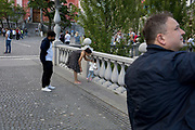 Held by a parent, a young child squeezes between the pillars of one of the Triple Bridges (Tromostovje) in the Slovenian capital, Ljubljana, on 25th June 2018, in Ljubljana, Slovenia.