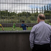 CARRICK-ON-SHANNON, IRELAND - AUGUST 18, 2017: A local man watches a group of Kurdish playing football in a leisure centre in Carrick-on-Shannon, a small town in the west of Ireland of just five thousand people where a group of Kurdish refugees were resettled from Iraq about 11 years ago. CREDIT: Paulo Nunes dos Santos for The New York Times