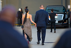 EXCLUSIVE: John Cena and Nikki Bella seen ahead of the WWE Wrestlemania 34 Hall Of Fame 2018 in New Orleans. The two who are staying tight lipped about their planned wedding could be seen walking along with fingers interlaced. Nikki, the 'Total Divas' star, looked stunning in a figure hugging sparkling long dress with a slit which showed off her legs and red high heels, while Cena could be seen in a dark suit with an orange tie. 06 Apr 2018 Pictured: John Cena, Nikki Bella. Photo credit: MEGA TheMegaAgency.com +1 888 505 6342