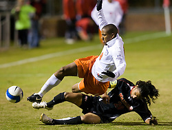 Maryland defender A.J. Delagarza (20) tackles the ball from Virginia Cavaliers forward/midfielder Ross LaBauex (8).  The Virginia Cavaliers fell to the Maryland Terrapins 2-1 in NCAA Soccer at Klockner Stadium on the Grounds of the University of Virginia in Charlottesville, VA on October 31, 2008.