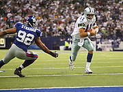 IRVING, TX - OCTOBER 23:  Quarterback Drew Bledsoe #11 of the Dallas Cowboys runs the ball for a 1 yard touchdown in the 2nd quarter while being chased by Michael Strahan #92 of the New York Giants at Texas Stadium on October 23, 2006 in Irving, Texas. The Giants defeated the Cowboys 36-22. ©Paul Anthony Spinelli *** Local Caption *** Drew Bledsoe;Michael Strahan