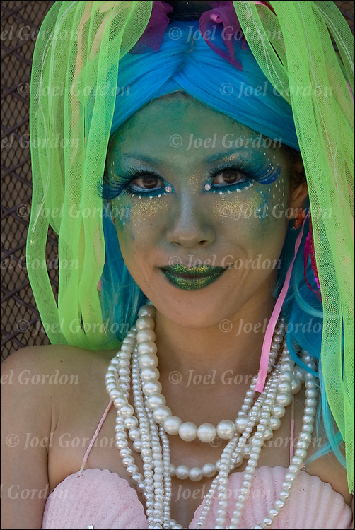 Close up of colorful Mermaid Parade marcher wearing costume  before the start of the parade in Coney Island.