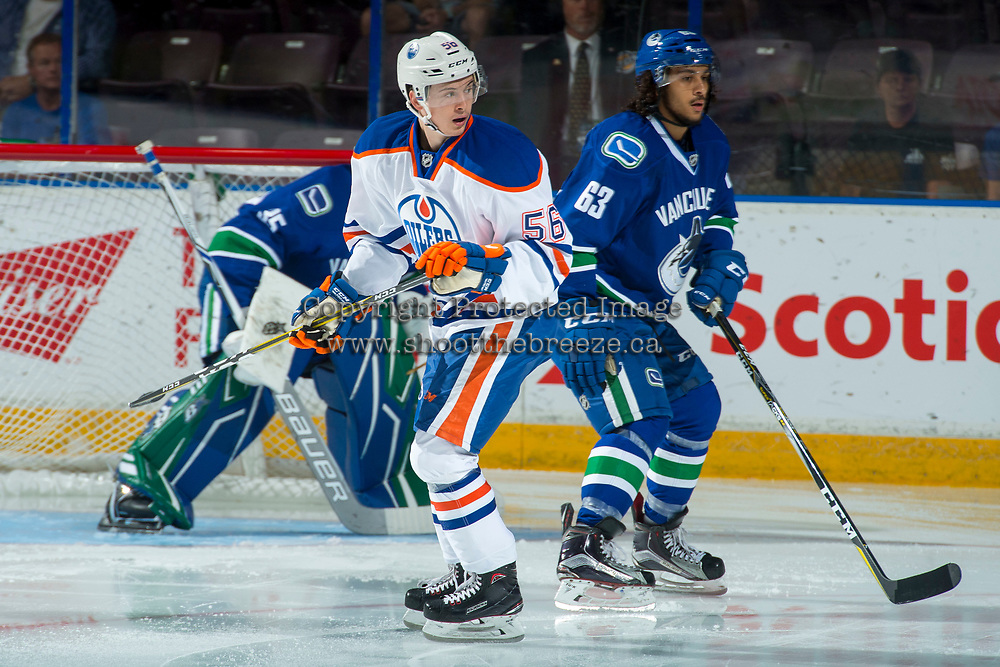 PENTICTON, CANADA - SEPTEMBER 11: Jalen Chatfield #63 of Vancouver Canucks back checks Kailer Yamamoto #56 of Edmonton Oilers on September 11, 2017 at the South Okanagan Event Centre in Penticton, British Columbia, Canada.  (Photo by Marissa Baecker/Shoot the Breeze)  *** Local Caption ***