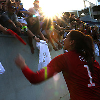 ORLANDO, FL - OCTOBER 25: Hope Solo #1 of USWNT signs autographs for fans after a women's international friendly soccer match between Brazil and the United States at the Orlando Citrus Bowl on October 25, 2015 in Orlando, Florida. (Photo by Alex Menendez/Getty Images) *** Local Caption *** Hope Solo