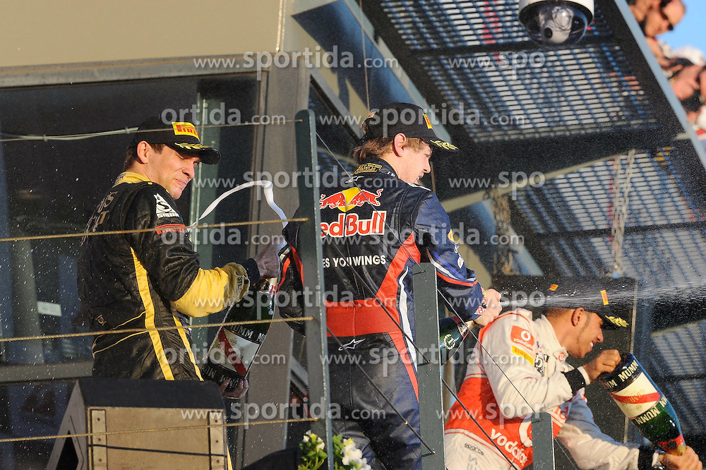 27.03.2011, Albert-Park-Circuit, Melbourne, AUS, F1 Großer Preis von Australien, Melbourne 2011, Race 01, im Bild Podium - Vitaly Petrov (RUS), Lotus Renault GP - Sebastian Vettel (GER), Red Bull Racing - Lewis Hamilton (GBR), McLaren F1 Team during Formula One Grand Prix of Australia at Albert-Park-Circuit Melbourne on 27/3/2011. EXPA Pictures © 2011, PhotoCredit: EXPA/ nph/ Dieter Mathis       ****** only for AUT & SLO ******