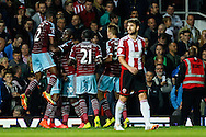 Diafra Sakho of West Ham United (2nd left) celebrates scoring the opening goal with team mates during the Capital One Cup match at the Boleyn Ground, London<br /> Picture by David Horn/Focus Images Ltd +44 7545 970036<br /> 26/08/2014