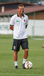 24.07.2015, Sportplatz, Walchsee, AUT, Trainingslager, FC Augsburg, im Bild Markus Weinzierl (Trainer FC Augsburg), lacht, gut gelaunt, mit Ball auf dem Trainingsplatz // during the Trainingscamp of German Bundesliga Club FC Augsburg at the Sportplatz in Walchsee, Austria on 2015/07/24. EXPA Pictures © 2015, PhotoCredit: EXPA/ Eibner-Pressefoto/ Krieger<br /> <br /> *****ATTENTION - OUT of GER*****