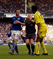 Photo. Jed Wee.<br /> Everton v Leeds United, FA Barclaycard Premiership, Goodison Park, Liverpool. 28/09/2003.<br /> Tempers come to boil as Leeds' Roque Junior (R) comes to a shoving match with Everton's James McFadden as referee Paul Durkin tries to keep them apart.