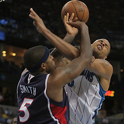 05 November 2008:  New Orleans Hornets center Tyson Chandler (6) draws a foul from Atlanta Hawks forward Josh Smith (5) during a 87-79 victory by the Atlanta Hawks over the New Orleans Hornets at the New Orleans Arena in New Orleans, LA..