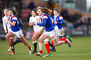 French player Bourdon Pauline breaks free and scores a try in the second half during the Women's 6 Nations match between England Women and France Women at the Keepmoat Stadium, Doncaster, England on 10 February 2019.