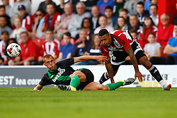 Steve Sidwell of Stoke City sliding tackle on Andre Gray of Brentford - Mandatory by-line: Jason Brown/JMP - Mobile 07966 386802 25/07/2015 - SPORT - FOOTBALL - Brentford, Griffin Park - Brentford v Stoke City - Pre-Season Friendly