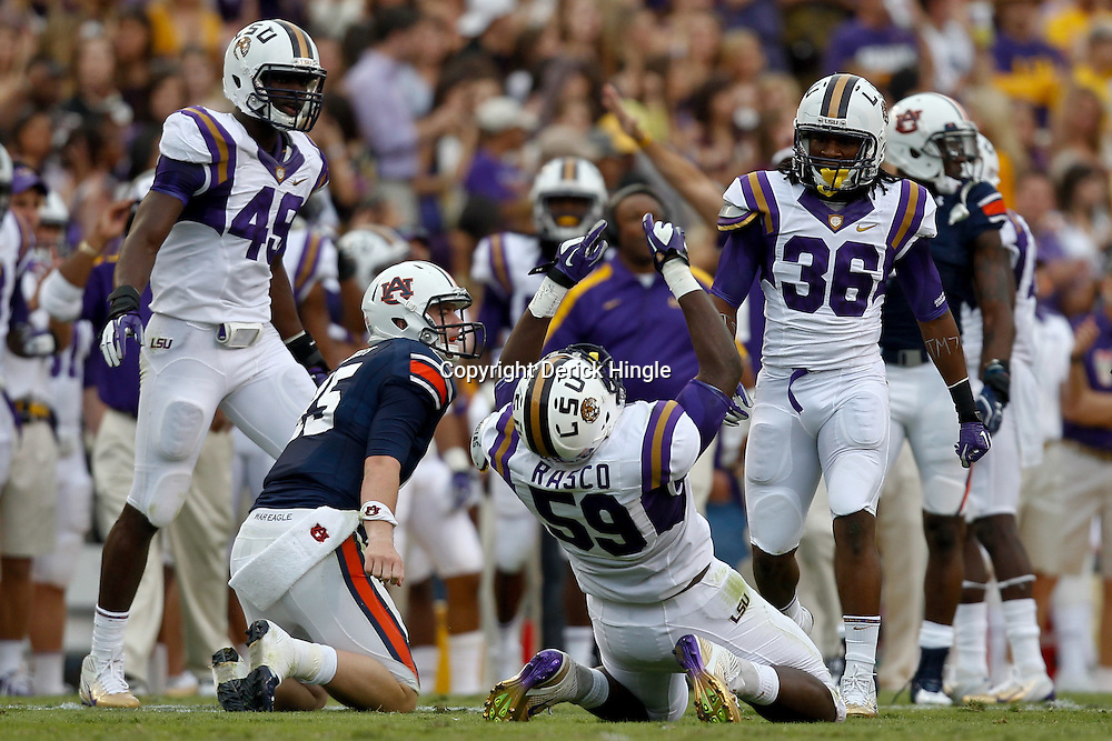October 22, 2011; Baton Rouge, LA, USA; LSU Tigers defensive tackle Anthony Johnson (56) celebrates after a sack of Auburn Tigers quarterback Clint Moseley (15) during the second half at Tiger Stadium. LSU defeated Auburn 45-10. Mandatory Credit: Derick E. Hingle-US PRESSWIRE / © Derick E. Hingle 2011