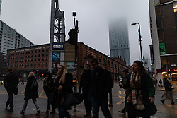 © Licensed to London News Pictures . 24/01/2019. Manchester , UK . Fog shrouds the upper floors of the Beetham Tower on Deansgate in Manchester City Centre , as commuters head to work this morning (Thursday 24th January 2019) . Photo credit : Joel Goodman/LNP
