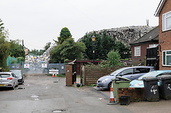 © Licensed to London News Pictures. 11/07/2014<br /> Environment agency officers on look out in the two cars parked to the left of picture.<br /> The Environment Agency has two officers posted out side the Waste4fuel site in Kent after local people reported seeing three lorry loads of waste being delivered on Monday (7.07.2014) to the St Pauls Cray site.  The Environment Agency has served an enforcement notice on Waste4Fuel to stop any further waste being brought into the site. <br /> This means any person depositing waste at Waste4Fuel will be committing an offence and may face action from the Environment Agency. <br /> Several conditions need to be met before further waste can be accepted at the site. <br /> The Environment Agency is waiting for a written decision from the High Court after it dismissed a contempt of court case last week for failure to maintain fire breaks and store new waste separately at the site. <br /> <br /> (Byline:Grant Falvey/LNP)