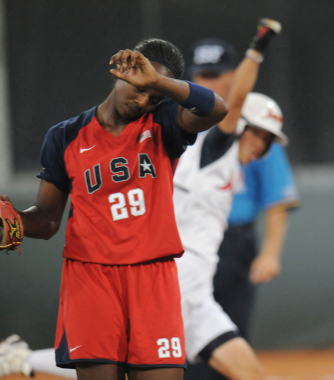2008 OLYMPIC GAMES - SOFTBALL- 082108 - USA shortstop Natasha Whatley reacts as Japan's Eri Yamada rounds second base with a solo home run to lead off the fourth inning, giving Japan a 2-0 lead.