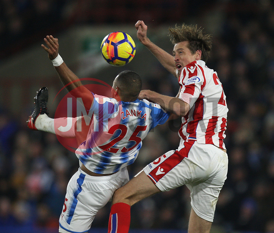 Mathias Zanka Jorgensen of Huddersfield Town (L) and Peter Crouch of Stoke City in action - Mandatory by-line: Jack Phillips/JMP - 26/12/2017 - FOOTBALL - The John Smith's Stadium - Huddersfield, England - Huddersfield Town v Stoke City - English Premier League