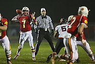 Marion's Trevor Hardman (7) throws a pass to Ethan Herren (2) during the first half of the game between the Solon Spartans and the Marion Indians at Thomas Park Field in Marion on Friday evening, October 5, 2012.