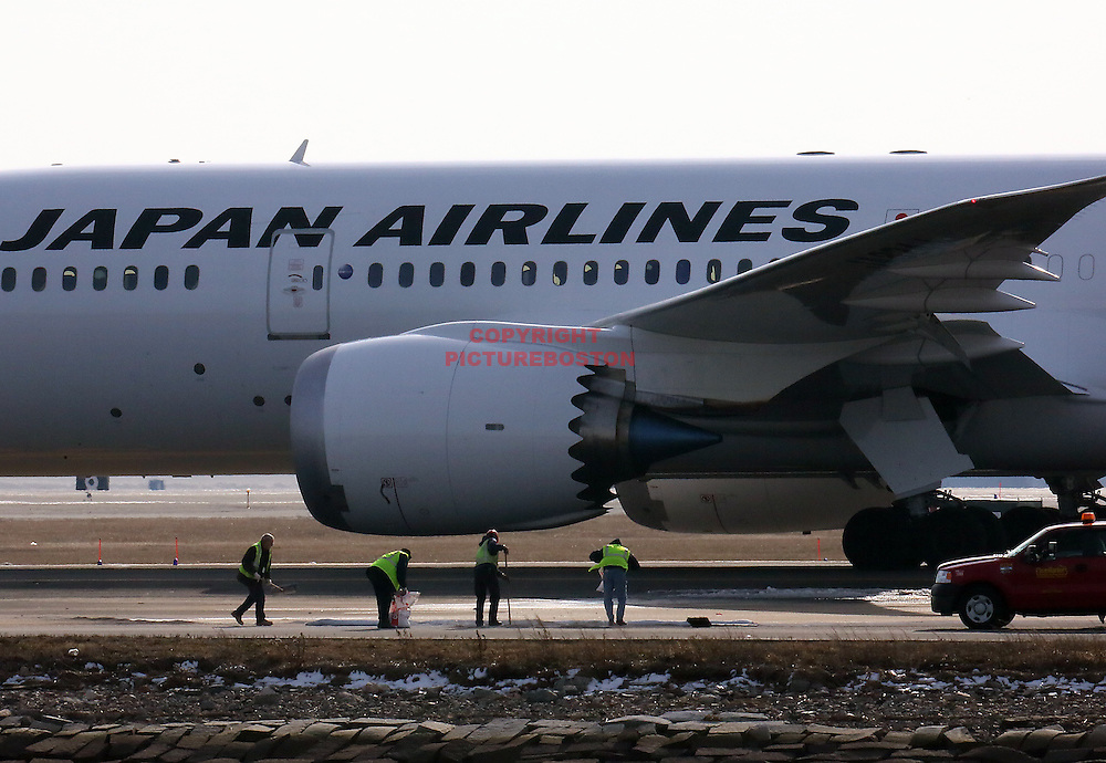 (Boston,MA-01/08/13)- Massport firefighters and other officials are seen at a fuel leak involving a Japan Airlines 787 Dreamliner today, January 8, 2013.Staff photo by Mark Garfinkel.